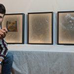 Aedan Gardill demonstrates his portraits